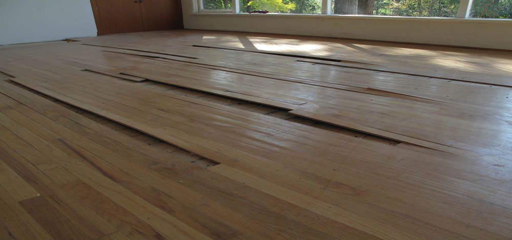 Blown wood flooring due to moisture content or water damage